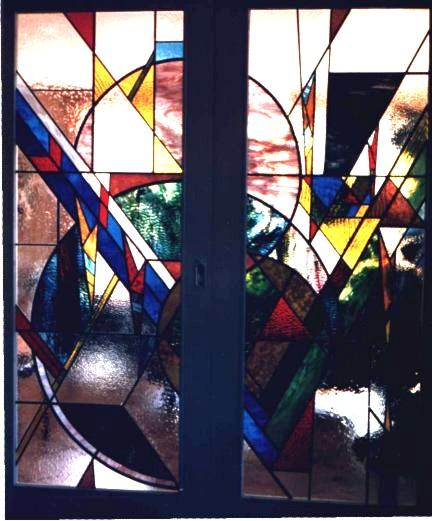 Decoratieve schuifdeuren, uitgevoerd in glas in lood