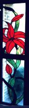 Glas in lood zijpaneel met bloem bij voordeur