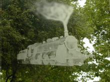 Gezandstraald raam met treinafbeelding